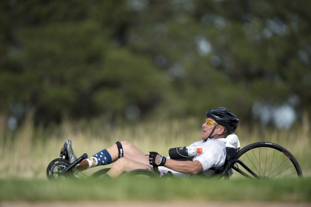 Team SOCOM Master Sgt. Curtis Allen pedals a recumbent cycle during the 2018 DoD Warrior Games cycling competition