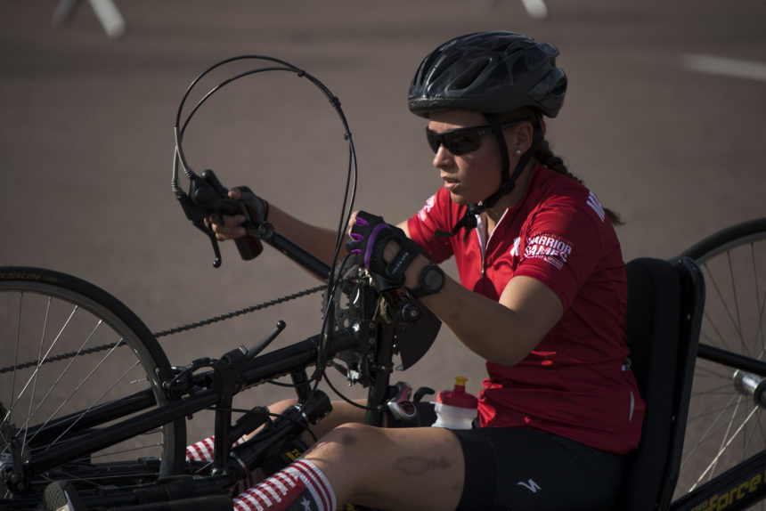 Team Marine Corps veteran Cpl. Tisha Knickerbocker powers a hand cycle during the 2018 DoD Warrior Games